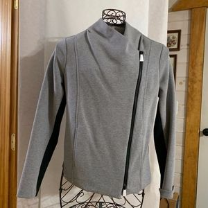 Asymmetrical zippered long sleeved jacket